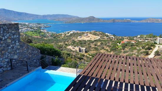 Elounda Solfez Villas: View from the middle floor balcony/terrace. Mirabella bay and Elounda town.