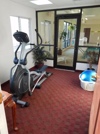 """Aurora, IL: The """"exercise room"""". Only an elliptical machine, small stability ball, and TV."""
