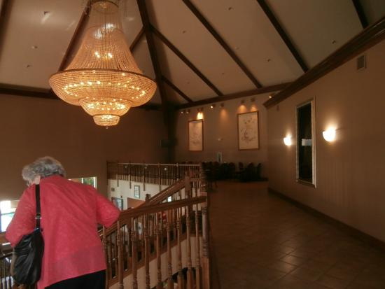 Precious Moments Hotel: Dining area is beneath the two framed prints on the back right. The serving area is across the h