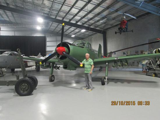 A member of the Ashburton Aviation Museum, volunteer team standing by just three of the aircraft