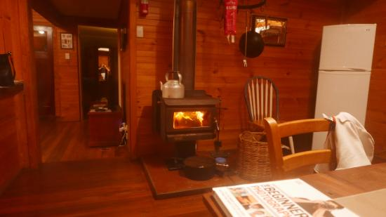 Cape Howe Cottages: Lovely wood burning stove in the kitchen and a kettle simmering for endless cups of tea.