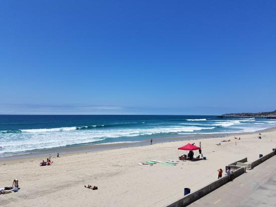 Blue Sea Beach Hotel: looking north along the beach/boardwalk from the balcony