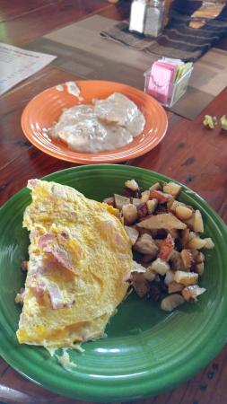 Welaka, FL: Ham and cheese omelet with home fries and biscuit with gravy.