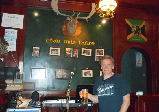 GuiLin HouYuan AiErLan JiuBa: Wearing an American shirt in an Irish pub drinking Chinese beer!