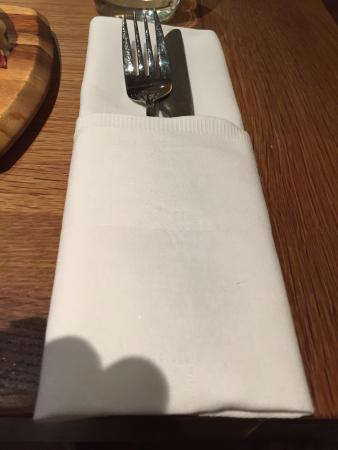 Thorpe le Soken, UK: Cutlery sparkling and placed in a folded napkin.