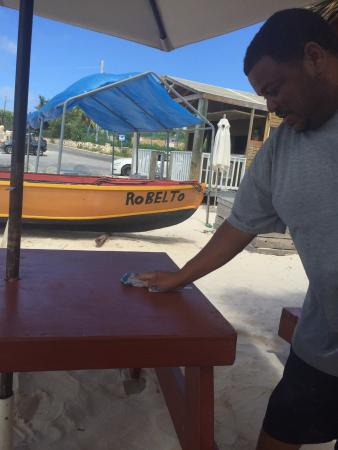 Island Harbour, Anguilla: He is cleaning up after  what a nice boy