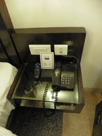 Hotel Taj Resorts: Bedside shelf with phone for reception (another hung on the shower room wall)