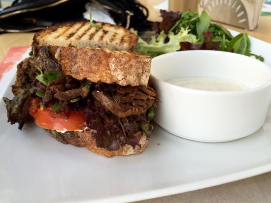 Beef brisket sandwich with tomatoes and horseradish and small salad 4/5.  Great sandwich lunch ti - Picture of Barsalata restaurant, Dubai -  Tripadvisor
