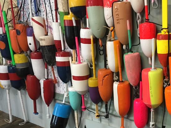 Bath, ME: The Coast of Buoys. The interactive wall of buoys identifying local lobsterman/women.