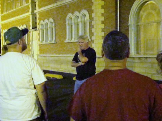 Haunted Decatur: Tour host John Winterbauer tells the group the history behind one of Decatur's haunted locations