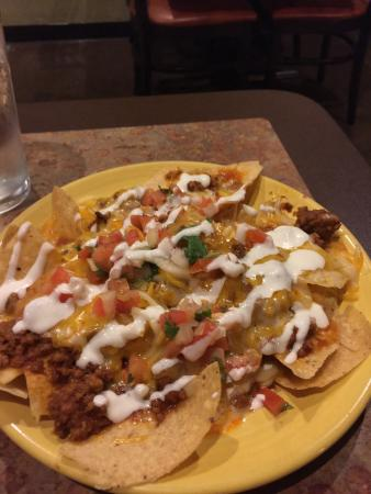 Mukwonago, WI: Good meal. Flavorful food. Horchata was fresh! Nachos were plentiful (small plate pictured) and
