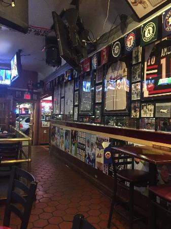 Bobby Valentine's Sports Gallery: walls are covered like this throughout the entire bar.