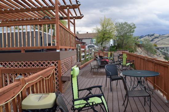 Terrace with hot tub on left Picture of Riverside Cottages
