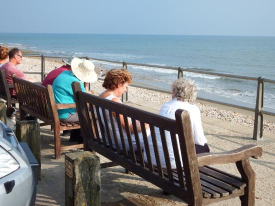 Charmouth, UK: or sit on one of many benches along the sea front