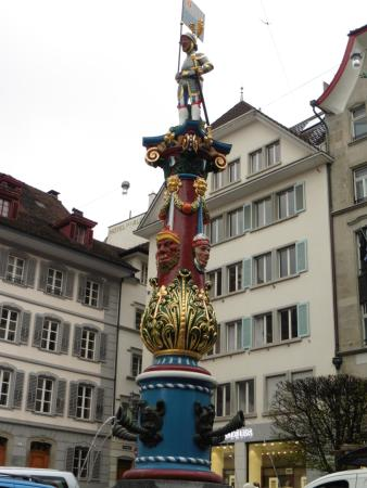 Old Town Lucerne: An ornate Mardi Gras fountain in a town square.