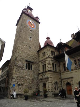 Old Town Lucerne: City clock tower and Lucene flag in blue and white.