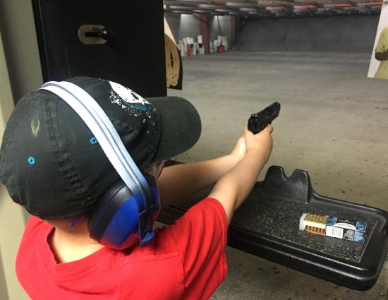 This a photo of my son who is 9 yrs old shooting for the first time at The Gun Shop in Leesburg,