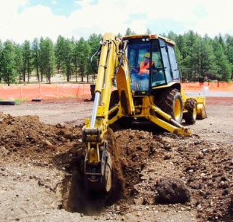 Using a backhoe is the fun way to dig a trench! - Picture of Big Toy