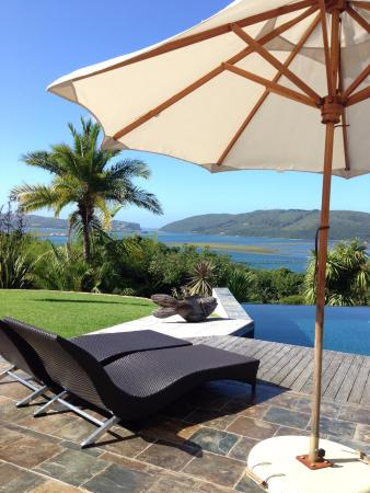 Cambalala: Garden with infinity pool and views over lagoon and Knysna Heads