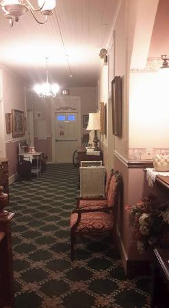 Hotel Strasburg: The upstairs hall. Notice the wheelchair and doctor's hand washing stand from when this was a ho