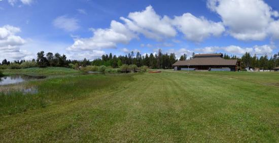 Bend-Sunriver RV Campground: view of clubhouse from tennis courts.
