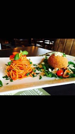 Penicuik, UK: Deep fried stuffed mozzarella ball in breadcrumbs , served with spaghetti Napoli!