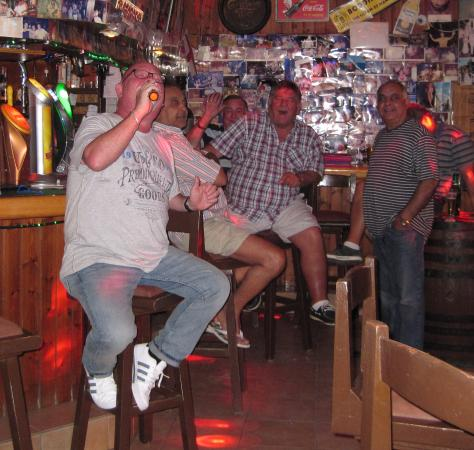"Yia-Mas George's Pub Protaras Cyprus: Dave ""at the bar"" belting one out!"