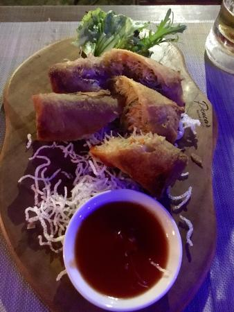 Pencar Seafood & Grill: Crunchy seafood spitting rolls with a sweet/spicy Sambal dipping sauce. Delicious!