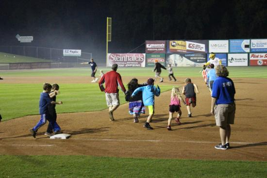 Appleton, WI: Kids running the bases after the game