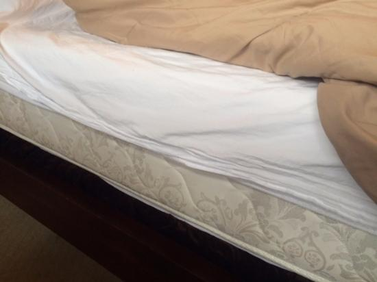 The Mansion at Maple Heights: ill fitting sheets do not cover mattress much less your body