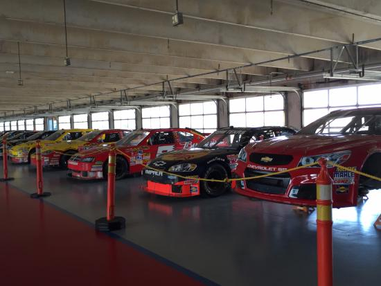 Texas Motor Speedway: Race cars in the garage.