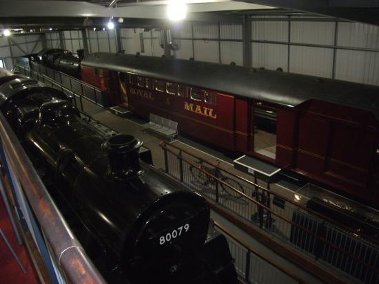 Highley, UK: Main hall of the Engine Shed with the Mail coach