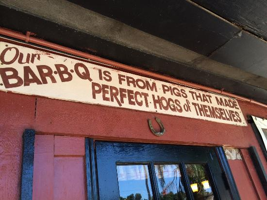 "The Pit: Love this sign: BBQ ""from pigs that made perfect hogs of themselves"""