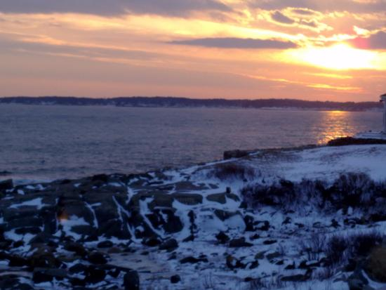 York, ME: Sunset in January looking across the bay having the lite house at your back,