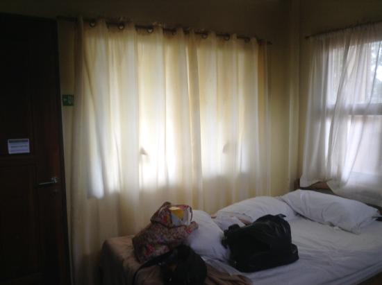 curtains too thin to block light from outside - Picture of La Luz ...
