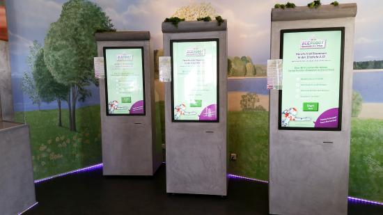 large touchscreens for selecting the ice cream of your choice