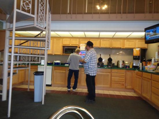 """Days Inn by Wyndham Hays: Breakfast area - """"Red"""" the great employee has the cap/plaid shirt on"""