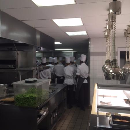 Debriefing in kitchen picture of eleven madison park for Kitchen 1883 reviews