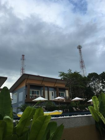 A RESORT CLOSELY SURROUNDED BY 3 BIG CELL PHONES TOWER ANTENNAS