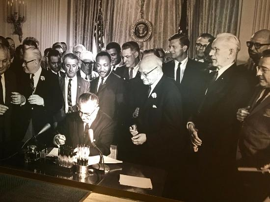 Johnson signing the Civil Rights act of 1964