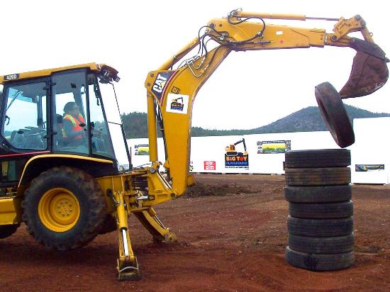 Williams, AZ: Whoa! That's the 8th tire being stacked by the backhoe.