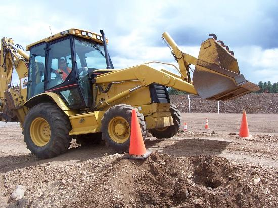 Williams, AZ: Up and over the bump in the obstacle course with the backhoe.