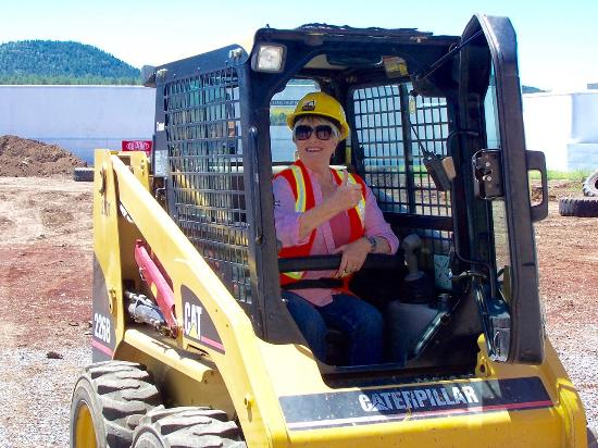 Williams, AZ: A big smile come with a skid steer adventure.