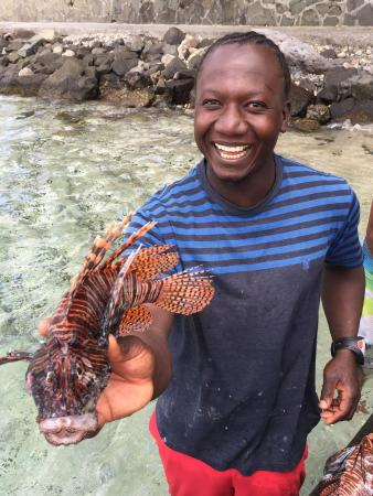 Dive Bequia: Our Dive Guide, Max, preparing lionfish for dinner