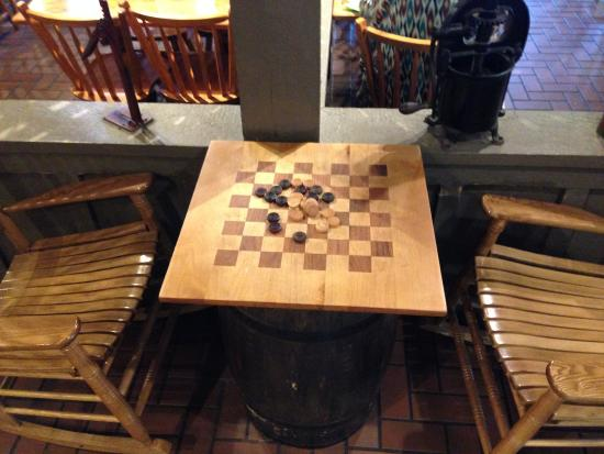 Commerce, GA: Game of Checkers by fireplace