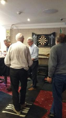 Crown Inn: Some happy guest relaxing dart game