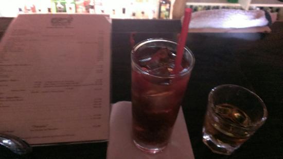 Nipomo, CA: Malibu coke with 2 cherries and a fireball shot on the side.