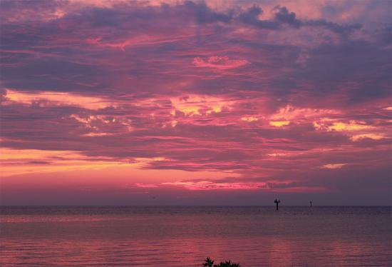 North Carolina Coast, NC: Watching the sun set over Pamlico Sound is a favored pastime on Ocracoke Island, NC.