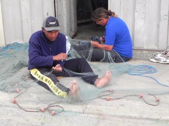 Marsaxlokk, Malta: Locals repairing nets