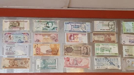 College Park, MD: A collection of foreign bills posted high on the walls